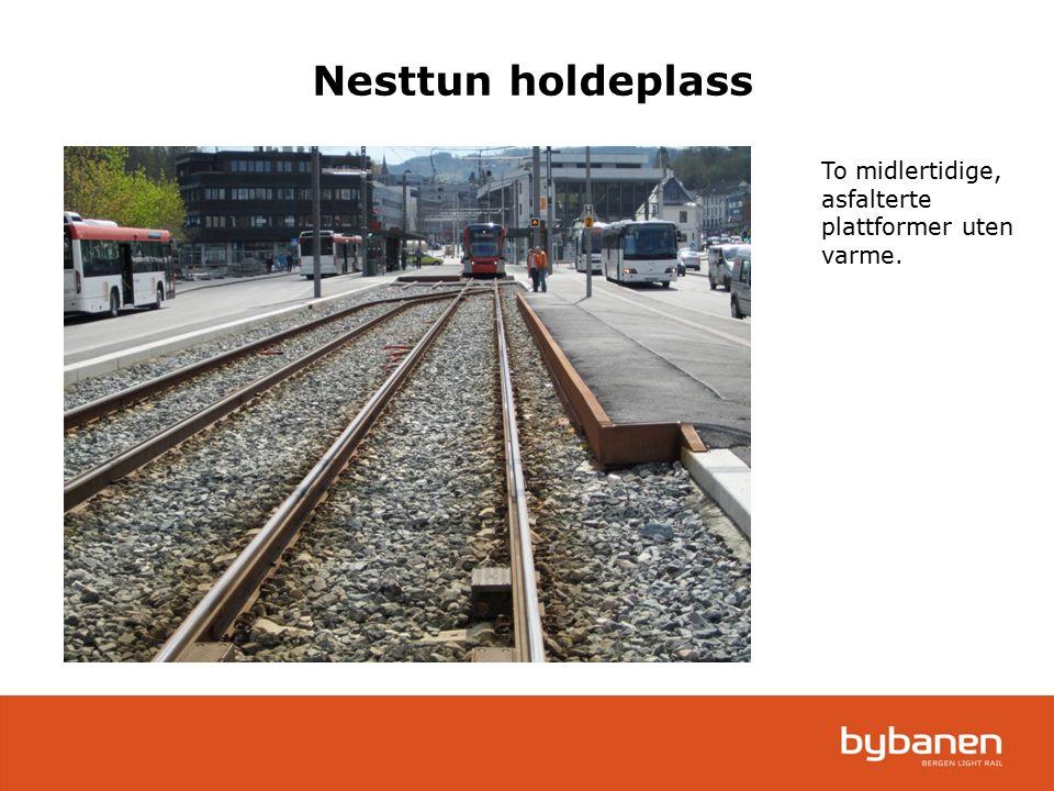 Nesttun holdeplass To midlertidige, asfalterte plattformer uten varme.