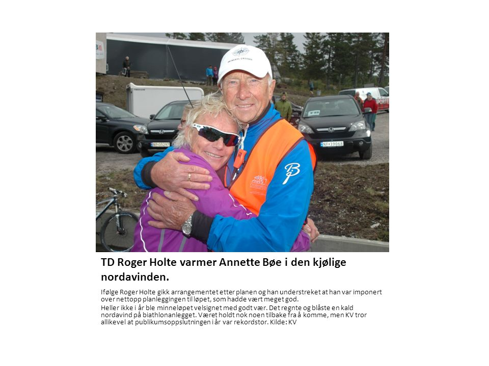 TD Roger Holte varmer Annette Bøe i den kjølige nordavinden.