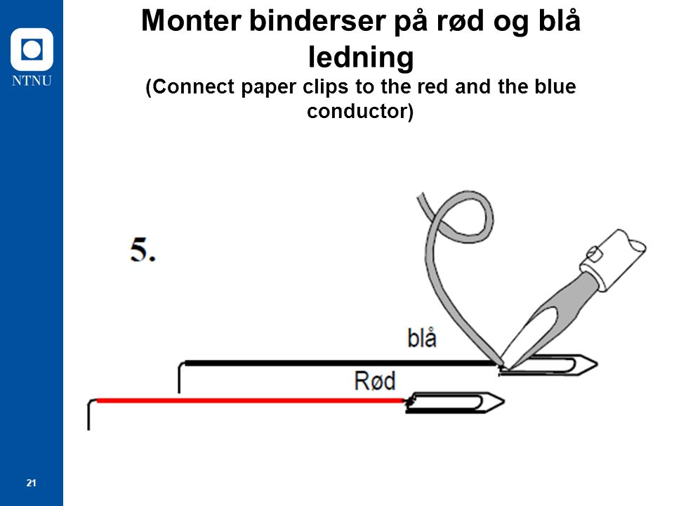 21 Monter binderser på rød og blå ledning (Connect paper clips to the red and the blue conductor)