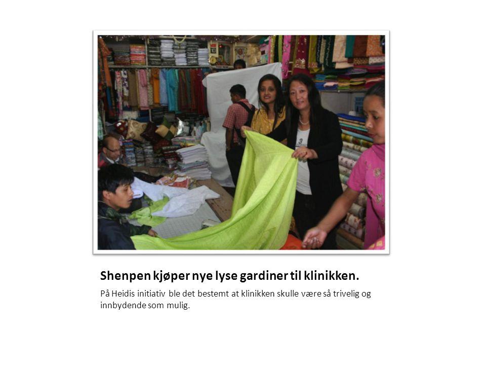 Shenpen kjøper nye lyse gardiner til klinikken. På Heidis initiativ ble det bestemt at klinikken skulle være så trivelig og innbydende som mulig.