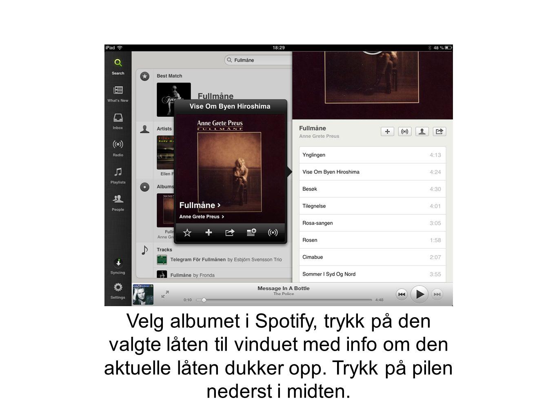 Velg albumet i Spotify, trykk på den valgte låten til vinduet med info om den aktuelle låten dukker opp. Trykk på pilen nederst i midten.