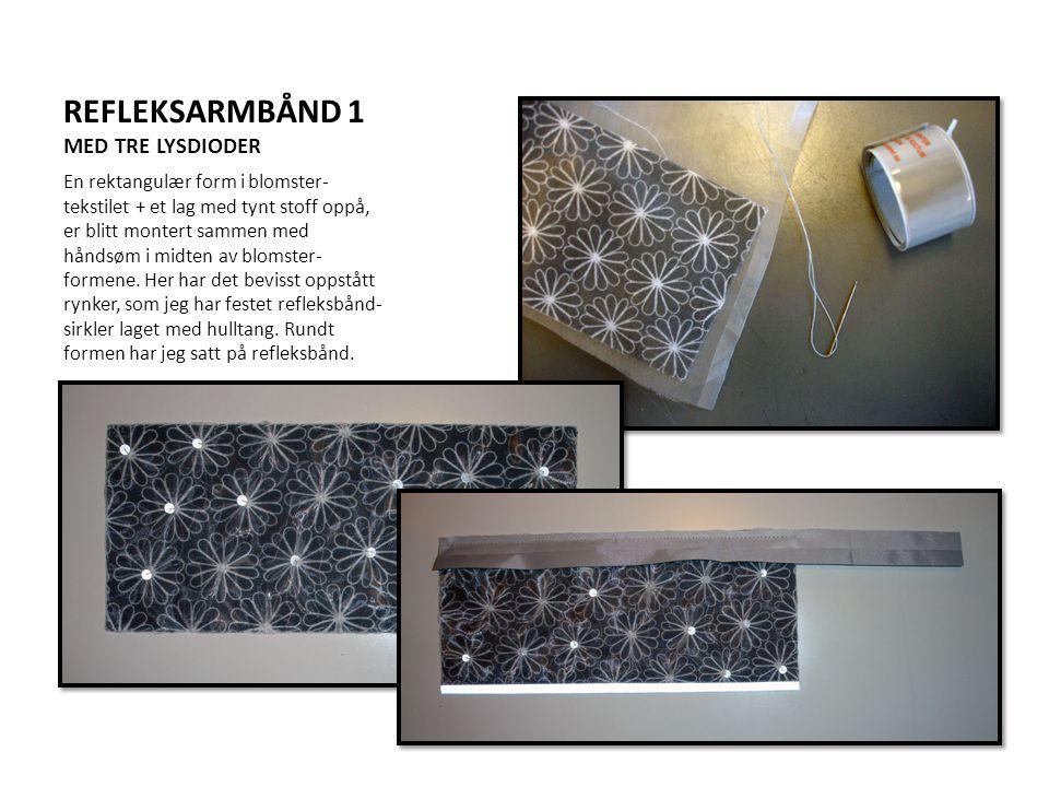 REFLEKSARMBÅND 1 MED TRE LYSDIODER En rektangulær form i blomster- tekstilet + et lag med tynt stoff oppå, er blitt montert sammen med håndsøm i midte