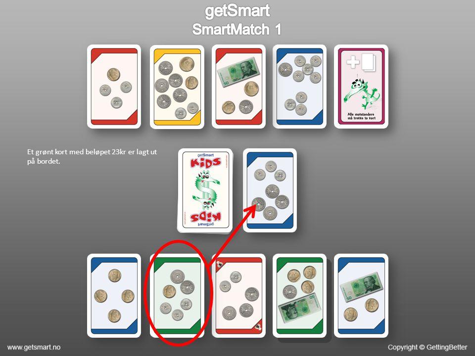 Et grønt kort med beløpet 23kr er lagt ut på bordet.