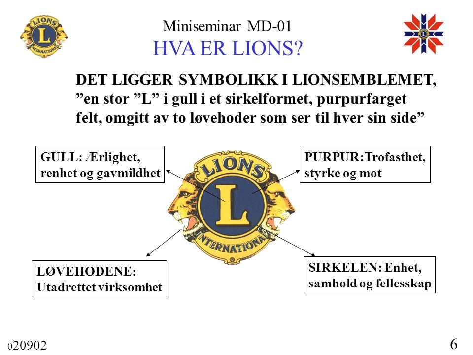 """Miniseminar MD-01 HVA ER LIONS? 0 20902 6 DET LIGGER SYMBOLIKK I LIONSEMBLEMET, """"en stor """"L"""" i gull i et sirkelformet, purpurfarget felt, omgitt av to"""